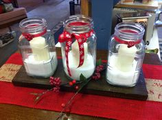 Three antique jars, some snow, a little ribbon and a sprig or two and Christmas is at your table.