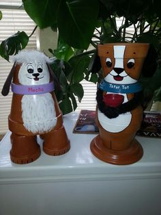 Clay flower pot doggies, I named after my own personal dog's!