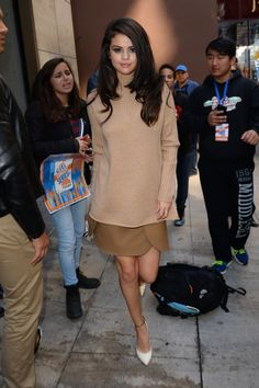 Selena Gomez rocks a monochromatic camel-hued outfit. See more of the songstress's best looks here.