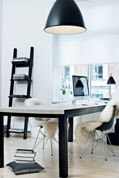Sheepskins on the molded Eames chairs - a touch of warmth and comfort.