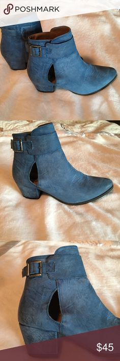Sky blue leather ankle booties with cutouts Free People blue leather booties- cutouts and a buckle strap. Made in Portugal. Gently loved. Free People Shoes Ankle Boots & Booties
