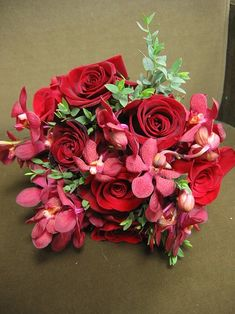 chinese wedding bouquets   tropical flowers and roses in red wedding bouquet.jpg