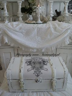 Brocante Simply Chic Living.  Love this white washed & stamped trunk for storage!