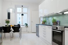Having Fun Cooking in Bewitching Scandinavian Kitchen Designs : Modern Black Chair And White Table Under Transparent Pendant Light Swedish Kitchen, Nordic Kitchen, Scandinavian Kitchen, Scandinavian Interior, Kitchen Black, Black Dining Chairs, Furniture Dining Table, Contemporary Small Kitchens, Small Kitchen Table Sets