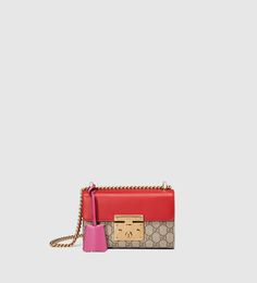 49dd978323c Shop the Padlock small GG shoulder bag by Gucci. A small structured GG  Supreme canvas bag with a leather top and our key lock closure.