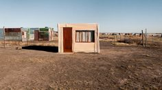 6)	Photo Tile: Shacks, built out of necessity   ID 5359 (Y)  By Frank Trimbos  From: Holland    Photo taken in: South Africa  Statement: Shacks are small improvised huts which are usually built on the outskirts of rural areas (townships) in South Africa. The residents are mostly immigrants who moved to the cities looking for work. They settle in squatter settlements, sometimes illegal or unauthorized. Squatter settlements are mostly found in developing nations like here in South Africa.