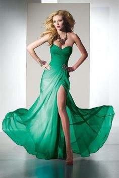 Love the dress if you pulled it up a wee bit more..... cleavage of that amosunt is not neccesary..
