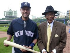 May 20: Derek Jeter, left, poses with Cubs great Ernie Banks before the game at Wrigley Field.