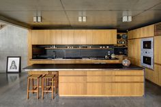 New South Wales House by Shelley Indyk | concrete walls, floors and ceilings + pale wooden joinery