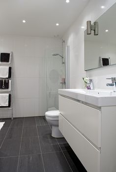 "white bathroom with charcoal floor tiles and caesarstone ""snow"