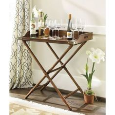 """Butlers Tray TableDimensions: Overall: 34""""H X 30 1/4""""W X 20 1/4""""D Stand w/o Tray: 31""""H X 27""""W X 15 1/8""""D Tray: 3 1/2""""H w/ 28 1/2""""W X 18 3/8""""D Interior Construction: Made of Pine with engineered hardwood and pine veneer."""
