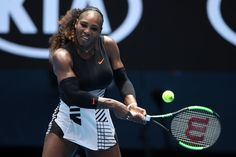 Serena Williams Photos Photos - Serena Williams of the United States plays a backhand in her first round match against Belinda Bencic of Switzerland on day two of the 2017 Australian Open at Melbourne Park on January 17, 2017 in Melbourne, Australia. - 2017 Australian Open - Day 2