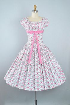 ♦ Vintage 1950s Novelty Print Sundress. As Shown on the 1955 Florida Fashions Catalog. ♦ Constructed in a Crisp White Cotton Fabric with a Pink Parisian Butterfly Print & Black Calligraphy Font of Le Papillon in French, Which Means The Butterfly. ♦ Scoop Neckline, Empire Bust with a