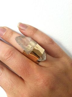 47. The prettiest shiny object I've ever owned: another FAVE a Quartz Crystal Brass Ring $48. mine was silver but VERY similar