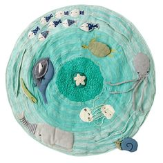 "Be on the Sea Activity Floor Mat | The Land of Nod  Marine themed baby activity mat.  It features a school of appliqued and embroidered sea creatures, rouched fabric for a wavelike texture and soft padding for extra comfiness. 36"" diameter"