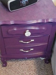 DIY thrift store nightstand makeover; purple paint, lace top, pearl drawer knob! What's not to love!! Check out blog for step by step instructions for this makeover.