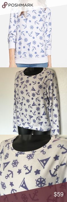 Wildfox Jumper This jumper is a white color with periwinkle designs. Gently used condition, has iconic fuzziness. Size M Wildfox Sweaters