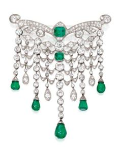 Platinum, emerald & diamond Devant de Corsage, France, circa 1925.  photo Sotheby's.  Designed as a graduated articulated swag supporting cabochon emerald drops weighing approximately 12.00 carats, the top set with an emerald-cut emerald weighing approximately 2.25 carats, and a square emerald-cut emerald weighing approximately 1.00 carat, spaced by 2 old European-cut diamonds weighing approximately 1.50 and 1.00 carats, set throughout with old European-cut, single-cut and rose-cut diamonds