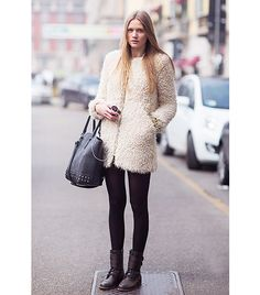 Highlighting the texture of the jacket with a blank, black canvas and a studded gold bracelet, this model-off-duty also keeps her hair sleek so as not to compete.