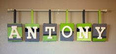 Over-the-crib baby name. I glued fabric and ribbon on canvases in various patterns, glued painted wooden letters on top & hung with a curtain rod.