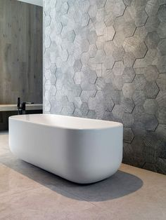 Объемная стена Bathroom Tile Ideas - Grey Hexagon Tiles // These grey hexagonal wall tiles stick out slightly from the wall to create a textured honeycomb look. Best Bathroom Tiles, Bathroom Tile Designs, Modern Bathroom Design, Bathroom Wall, Bathroom Interior, Master Bathroom, Bathroom Ideas, Bathroom Renovations, Stone Bathroom Tiles