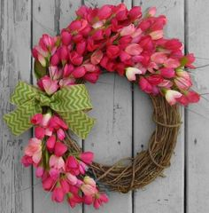 Pink mini tulips surround this grapevine wreath to greet your guest with the joy of Spring! This wreath also comes with a MONOGRAM. Please visit my Spring/Summer section to see listing and pricing:  https://www.etsy.com/shop/RefinedWreath?ref=hdr_shop_menu§ion_id=16548224   *****Complimentary Upgrade: UV Resistant Coating***** Each wreath purchase comes with a complimentary upgrade option for clear UV spray protection. This helps guard the artificial flowers against premature fading from UV…