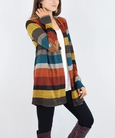 Evoke style reminiscent of cozy libraries and warm coffee shops with this charming cardigan boasting playful stripes and academic-chic elbow patches.