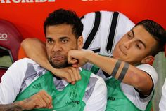 Dani Alves and Paulo Dybala of Juventus FC react during the Serie A match between AS Roma and Juventus FC at Stadio Olimpico on May 14, 2017 in Rome, Italy.