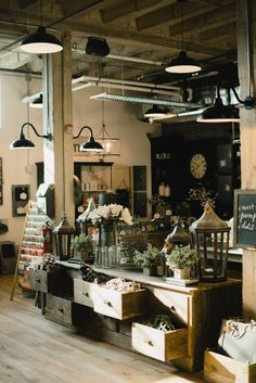 Magnolia Market - awesome vintage lighting and a huge cabinet that looks like it was salvaged from an old general store - Magnolia Homes