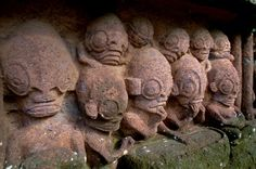 These strange statues are in the Marquesas Islands in the city Temehea-Tohu. These statues have been dated to two millennia.