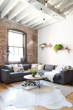 A young couple's Williamsburg industrial apartment. Still cozy, though, still cozy.        HomePolish The post Dreamy industrial Brooklyn home appeared first on Daily Dream Decor.