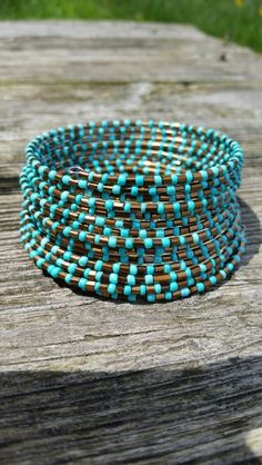 Copper and turquoise seed beads on 12 loops of memory wire.