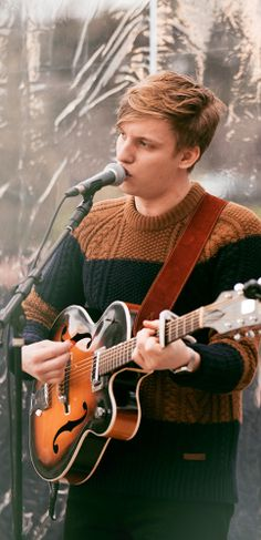A live performance by British musician George Ezra after the Burberry Prorsum Menswear A/W14 show in Kensington Gardens