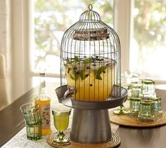Potentially a DIY if you can find a bird cage and a cake stand - Bird Cage Drink Dispenser Stand from Pottery Barn