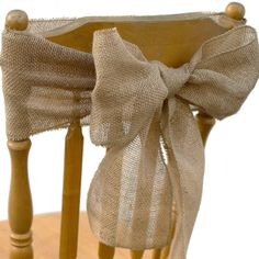 Add a flower or tulle in the center of the bow for a rustic elegant look (the price for the already-done sash here is so low it is not worth the trouble of DIY).