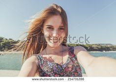 Beautiful urban woman taking picture of herself, selfie. Filtered image. - stock photo