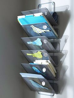 A hanging file organizer in a corner is the perfect way to hold papers. Decorate each section of a hanging file organizer with a cardstock bird and a small label so you can put supplies away in their place.