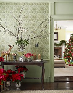 """Holiday Hallway - Arrange branches in a vase for an easy, elegant tabletop """"tree."""" This one is adorned with chandelier prisms and gold-painted walnuts. Read more: Holiday Decorating Ideas - Country Christmas Decorations - Country Living"""