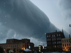 """""""A type of arcus cloud called a roll cloud. These rare long clouds may form near advancing cold fronts. In particular, a downdraft from an advancing storm front can cause moist warm air to rise, cool below its dew point, and so form a cloud. When this happens uniformly along an extended front, a roll cloud may form..."""""""