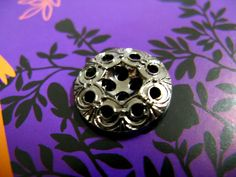 Metal Buttons - Funky Lovely Garden Grille Style Set 9 PIERCED Reflective Silver Metal Buttons.0.71 inch. $4.00, via Etsy.