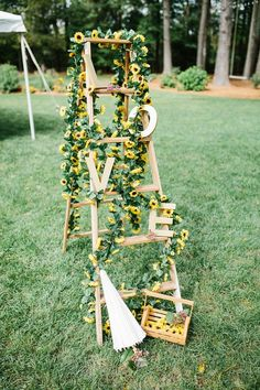 Love ladder with sunflower garland idea for a rustic wedding