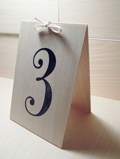 Farmhouse chic wood free standing table numbers. Numbers are hand-stamped.