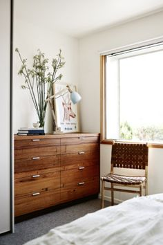 Renovated beach shack gallery 11 of 11 - Homelife  The master bedroom's chest of drawers is a richer take on the home's timber palette