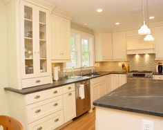 (I like the whole look of this kitchen) soapstone countertops