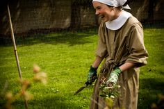 22-year-old Sister Lauren Franko tends to gardening during one of two daily work periods, she has been a Postulate (a newly entered nun) for two months.