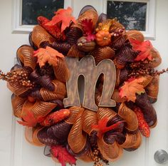 Fall deco mesh wreath. I like the Letter placed in the middle...