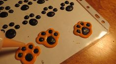Creating the tiger paws for the cupcakes and cake..