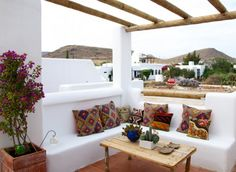 """""""The big cushions are from """"Aloja do Gato Preto"""" and the smaller are from a street market in Lucca in the Tuscany. Both are made from kilims."""""""