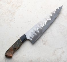 Stainless San Mai Chef Knife handmade by Salem Straub of Promethean Knives. Custom Kitchen Knives, Custom Knives, Cooking Supplies, Fun Cooking, Cool Knives, Knives And Swords, Damascus Chef Knives, Damascus Steel Chef Knife, Blacksmithing Knives