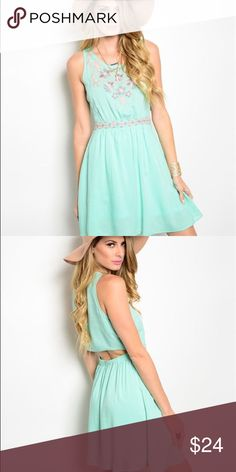 """Mint Dress This dress screams spring/summer. It features a floral embroidery along the yoke and waistband and has a scoop neckline. L:35"""" B:18"""" W:13"""" Dresses Midi"""